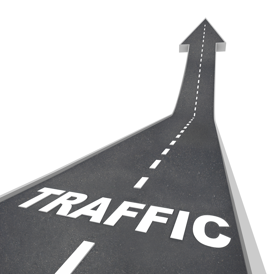 The word Traffic on a road rising up to represent increased acti