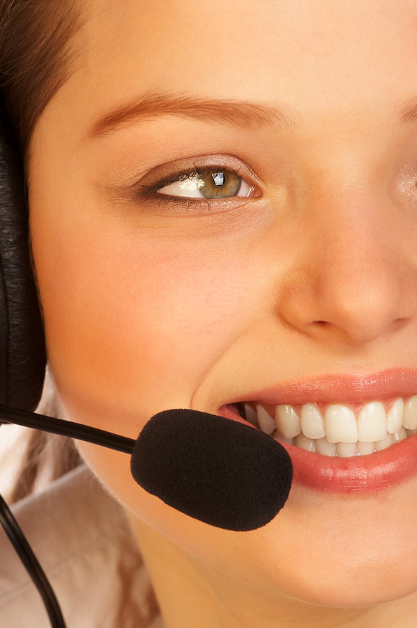 smiling attractive woman with a headset.